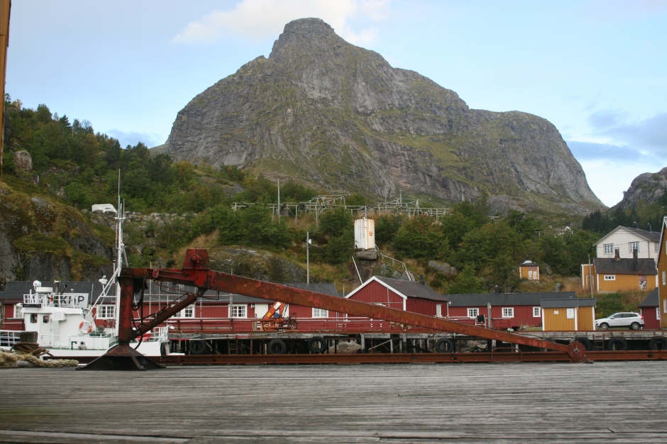 An old crane with Nusfjord in the back.