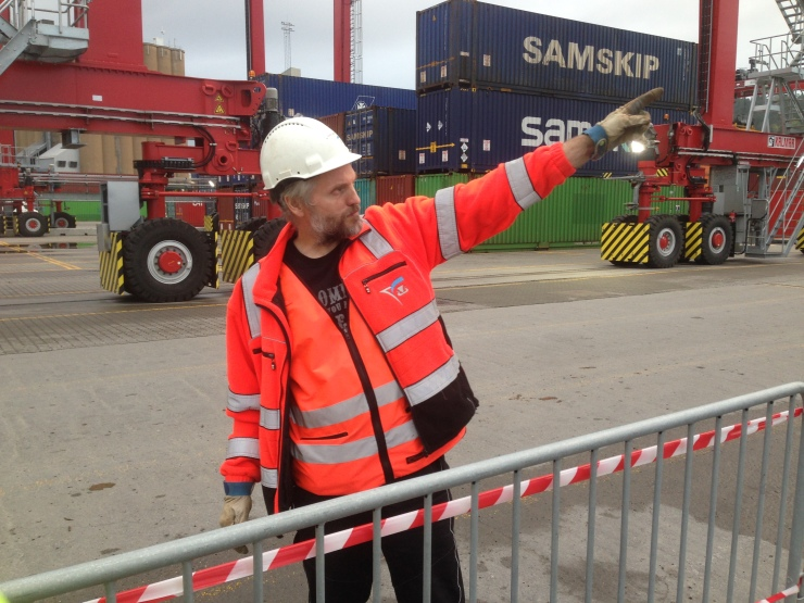 Svein Ervik pointing at the cranes.